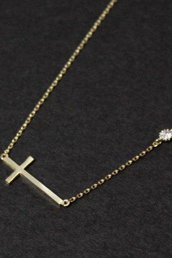 Sideways cross necklace with crystal